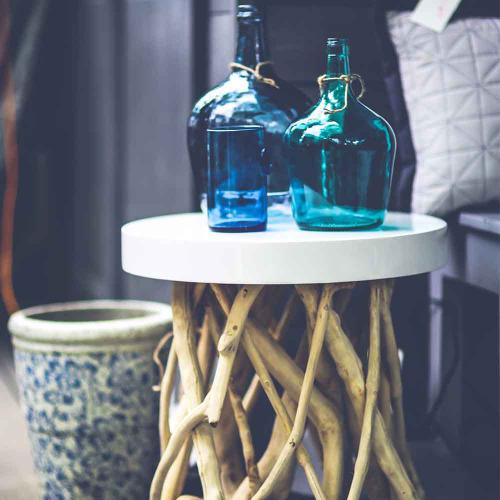 Big Sky Blinds - Nice end table with blue bottles on top